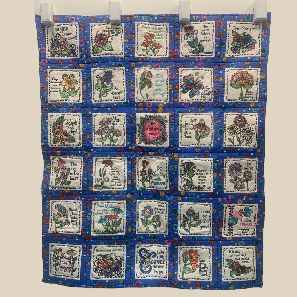 Image of the inspirational quilt that Marsha Creter made from Debi Payne Designs inspirational machine embroidered patterns