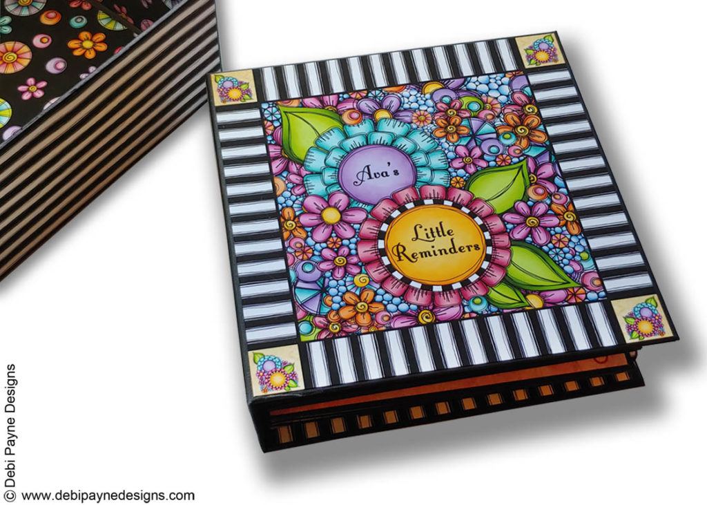 Front cover and box of Ava's Little Reminders mini scrapbook album by Debi Payne Designs.
