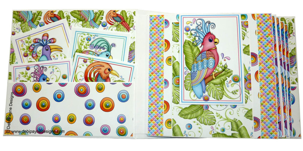 Inside front cover of book and page 1 of the mini scrapbook album featuring the Tropical Showbirds paper collection by Debi Payne Designs.